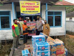 Berikan Bantuan Kepada Warga Terdampak Banjir, Kapolsek Muara Ancalong Turun Langsung Ke Posko