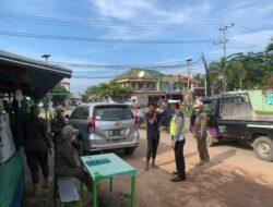Tekan Penyebaran Covid-19, Polres Kutim Lakukan Razia Protokol Kesehatan Di Simpang 4 APT Pranoto